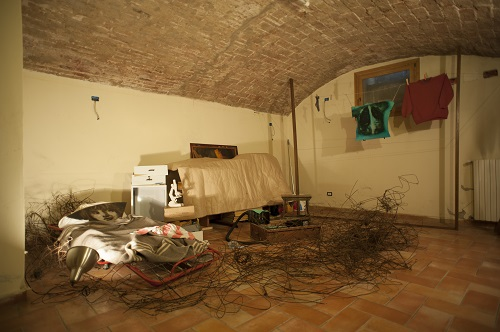 A. M. HOCH, Diary of a Young Boat in Three Movements: Young Boat in Bed (Third Movement), performance/ installation with cot painted mirror on pilllow, wires, found objects; dimensions variable, Cartoleria 18 Società Cooperativa; 2013