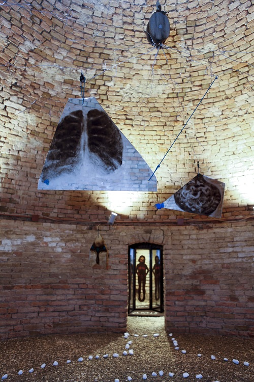 A. M. HOCH; Metamorfosi di una barca: first level of installation (circular basement floor) in castle tower: central room with painted mirrors suspended with wires and pulleys, with three alcoves with painted mirrors; approximately 13.78 ft (height) x 21.5 ft (diameter); 2011
