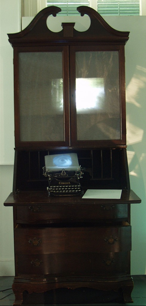 A. M. HOCH, interstices, DETAIL: armoire with embedded camera obscura reflecting the outside lawn and harbor, and typewriter with embedded video; 76 inches x 43 inches x 25 inches, 2002