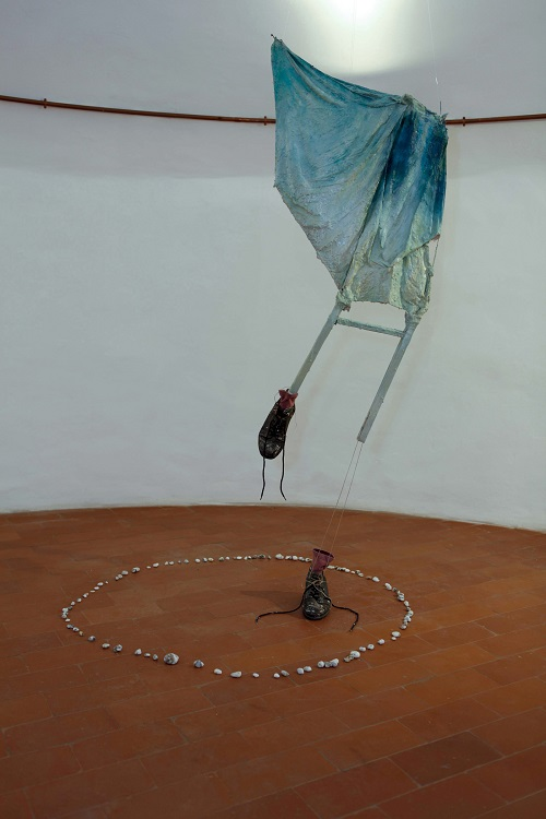 A. M. HOCH, third level of castle tower: Metamorphosis with Umbrella; mixed media including umbrella, resin, metal, and oil paint; approximately 73.6 x 23.6 inches; 2010/2011
