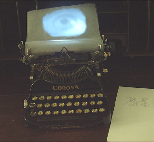 A. M. HOCH, interstices, DETAIL: typewriter with video loop of blinking eye projected onto page