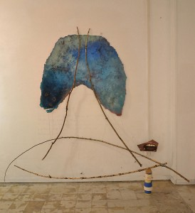 A. M. HOCH, Here Now Am (Breathing Vessel), studio installation, mixed media including oil on resin-coated fabric with embedded wires; painted mirror; branches; stack of masking tape; approximately 224 x 244 cm (88 x 96 inches), 2014