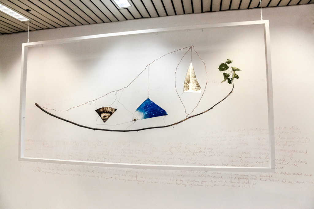 """A. M. HOCH, """"Young Boat (Future Reflection Sister Past)"""" installation at SetUp Art Fair 2015, painted mirrors, copper wire, branch; approx 130 x 240 cm, (51 x 94.5 inches); 2014"""