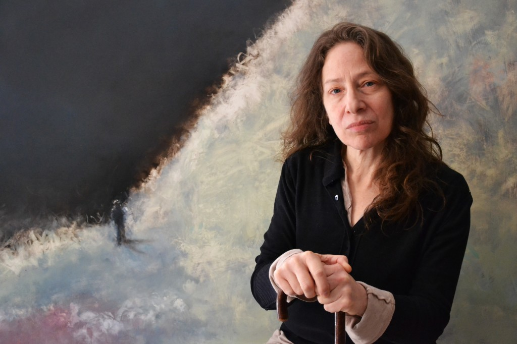 Photo of AM Hoch in front of <em>Sea Change</em> painting